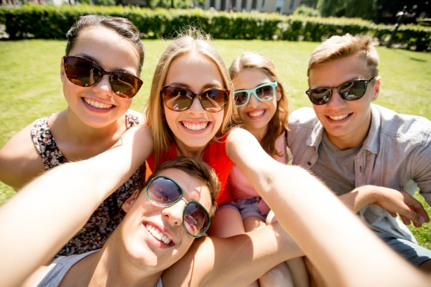 group-friends-taking-selfie-park